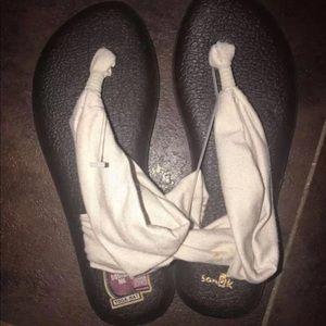 Sanuk sandals.